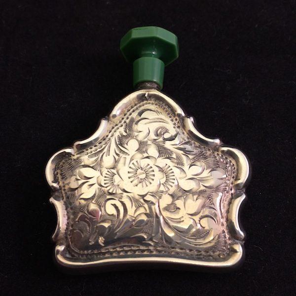 zilveren parfumfles